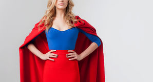 Superhero Woman. Young and beautiful blonde in image of superheroine. Close-up, place for text on the right. Superhero Woman. Young and beautiful blonde in the stock image