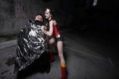 Superhero wrapping the criminal Royalty Free Stock Image