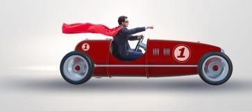 Superheroaffärsmannen som kör tappningroadster fotografering för bildbyråer