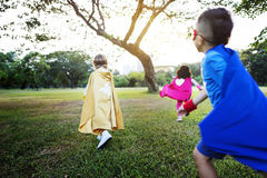 Superheroes Cheerful Kids Expressing Positivity Concept Royalty Free Stock Photos