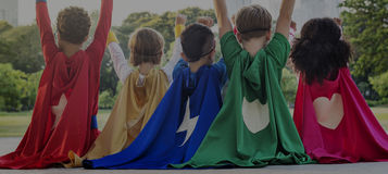 Superheroes Cheerful Kids Expressing Positivity Concept. Superheroes Cheerful Kids Expressing Positivity Stock Image