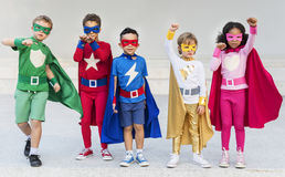 Superheroes Cheerful Kids Expressing Positivity Concept. Superheroes Cheerful Kids Expressing Positivity Stock Photo