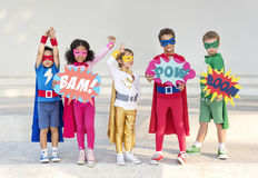 Superheroes Cheerful Kids Expressing Positivity Concept. Superheroes Cheerful Kids Expressing Concept Stock Image