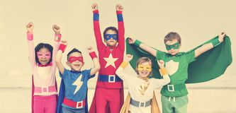 Superheroes Cheerful Kids Expressing Positivity Concept. Diverse children superhero costume cheerful Royalty Free Stock Image