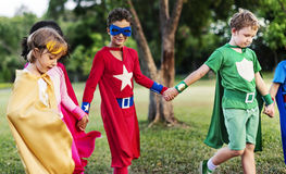 Superheroes Cheerful Kids Expressing Positivity Concept. Kids Enjoying the Summer Concept stock photo