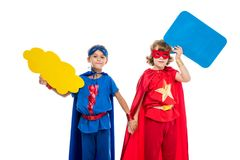 Superheroes with empty speech bubbles. Superheroes with holding empty speech bubbles holding hands, isolated on white Stock Images