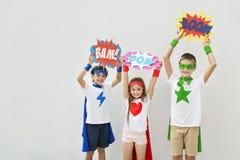 Superheroes Kids Costume Bubble Comic Concept. Superheroes Kids Costume Bubble Comic Stock Photography
