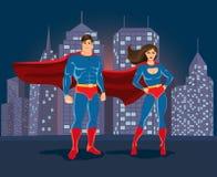 Superheroes på stads- landskapbackgound Arkivfoton