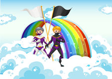 Superheroes in the sky near the rainbow Stock Images