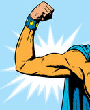 Superheroine arm flexing. Stock Photo
