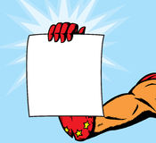 Superheroine female hand holding flyer. Superheroine holding page.  Anything can be put on it.  With , hand and flyer are on separate layers and can slightly be Royalty Free Stock Image