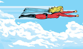 Superheroine flying in the clouds Stock Photos