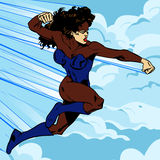 Superheroine flying in the clouds Stock Photography