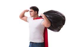 Superheromannen med avskrädesäcken som isoleras på vit Arkivfoto