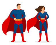 Superheropar av den plana stålmannen och superwomanen Arkivbilder
