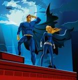 Superheropar Manliga och kvinnliga superheroes Arkivfoto