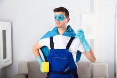 Superheroportier Holding Cleaning Equipments royalty-vrije stock fotografie