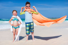 Superheros at a beach Royalty Free Stock Photos