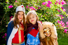 SuperHeroSisters. A backlit portrait of three sisters dressed in super hero costumes which vary in originality Stock Photography