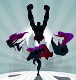 Superheroteam; Team die van superheroes, en vooraan vliegen lopen Royalty-vrije Stock Foto