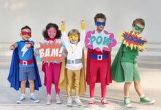 Superheroungar med supermakter royaltyfria bilder