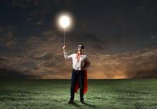 Superhombre con el globo Fotos de archivo libres de regalías
