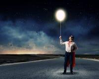 Superhombre con el globo Fotos de archivo