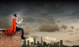 Superhombre en el tejado Imagen de archivo