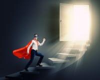 Superhombre en escalera Fotografía de archivo libre de regalías