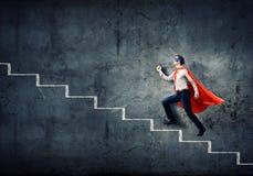 Superhombre en escalera Foto de archivo libre de regalías