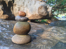 Superimposed waterfall pebble rock arranged on big stone Stock Images