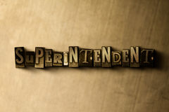 SUPERINTENDENT - close-up of grungy vintage typeset word on metal backdrop Stock Photos