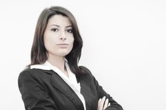 Superior business woman looking disaproving. Angry business woman looking with her hands on her arms showing her disaprovemant Royalty Free Stock Images