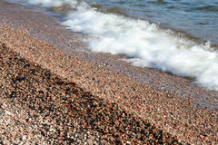 Superior Stones and Waves. Waves and pebbles on a natural beach. Lake Superior Provincial Park, Ontario Stock Photography