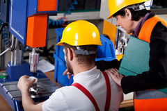 Superior with worker in warehouse Stock Images