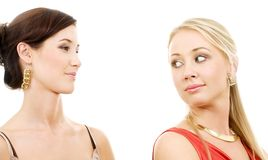 Superiority. Picture of two young girlfriends over white royalty free stock photos