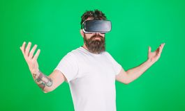 Superiority concept. Hipster on serious face raising hands while enjoy superiority in virtual reality. Guy with head stock photos