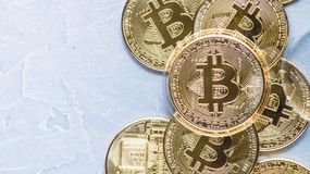 Superiority of the Crypto-currency: A bitcoin coin is among the various coins of the world on a gray background. Superiority of the Crypto-currency: A large royalty free stock image