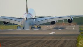 Superjumbo landing at Dusseldorf. Big wide-body airliner landing, slow motion stock footage