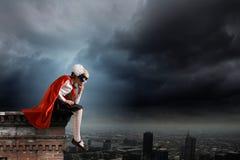 Superkid pensativo Fotografía de archivo libre de regalías