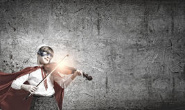 Superkid  playing violin Royalty Free Stock Images