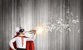Superkid with trumpet Stock Photos