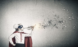 Superkid with trumpet Royalty Free Stock Photography
