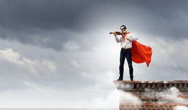 Superman avec le violon Image stock