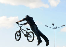 Superman at bmx dirt competition Royalty Free Stock Image