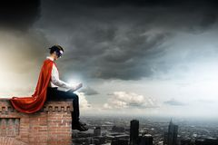 Superman with book royalty free stock photography