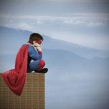 Superman. Child superman costume with cape house production royalty free stock image