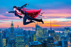The superman and the city in concept. Superman and the city in concept Royalty Free Stock Photography