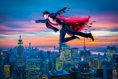 The superman and the city in concept. Superman and the city in concept Stock Photo