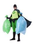 Superman d'Eco et déchets de ménage Photographie stock libre de droits
